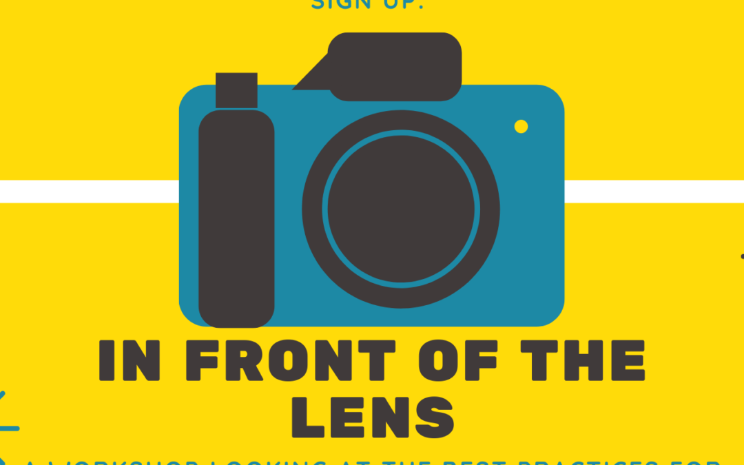 In front of the lens